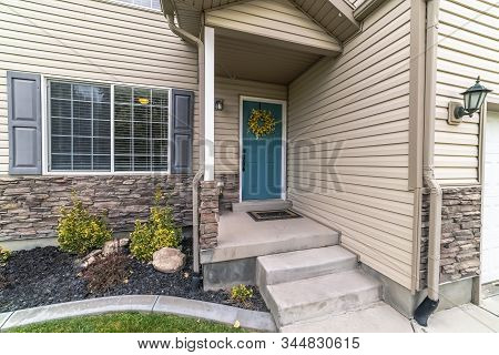 Concrete Steps Leading To A Front Door