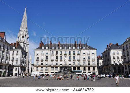 NANTES, FRANCE - CIRCA AUGUST 2011: Place Royale (royal square) in Nantes city centre. Saint Nicolas Basilica on the left side.