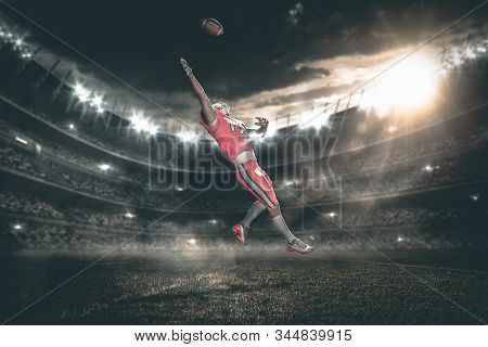 American Football Player Catches Ball In Midair