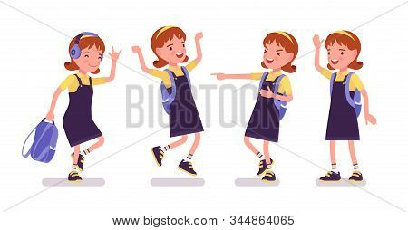 School Girl Positive Emotions. Cute Happy Small Lady In Pretty Pinafore Dress With Rucksack, Active