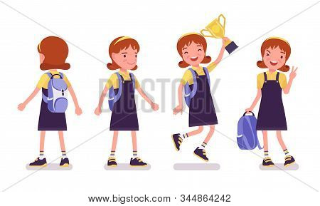School Girl Standing. Cute Small Lady In Pretty Pinafore Dress With Rucksack, Active Young Kid, Smar