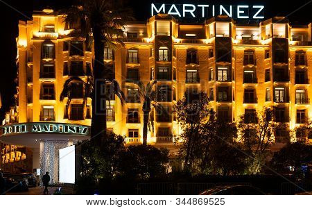 Cannes France, 28 December 2019 : Martinez Luxury Hotel Facade And Sign Illuminated At Night In La C
