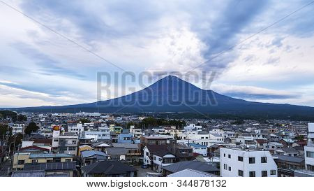 Fuji Mountain With Cityscape Over Blue Sky In The Afternoon At Fujinomiya, Shizuoka, Japan