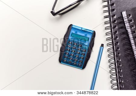 Calculating Tax Return Numbers And Figures On Office Desk Concept For Filling Tax Return Forms