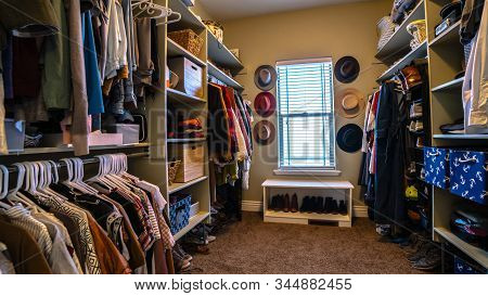 Panorama Frame Neat Walk-in Closet Full Of Clothes Day Light