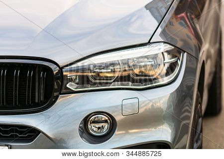 Close Up Photo Of Modern And Clean Car, Detail Of Headlight. Headlight Car Projector/led Of A Modern