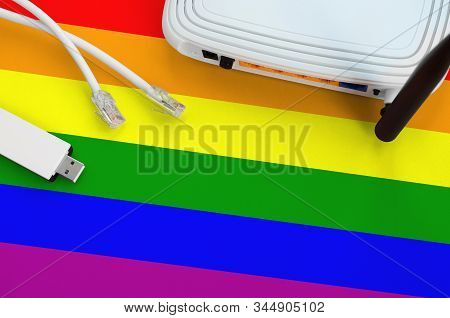 Lgbt Community Flag Depicted On Table With Internet Rj45 Cable, Wireless Usb Wifi Adapter And Router