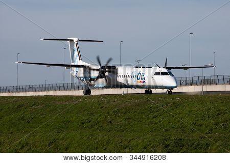 Amsterdam / Netherlands - April 12, 2015: Flybe Bombardier Dhc-8 Q400 G-kkev Passenger Plane Taxiing