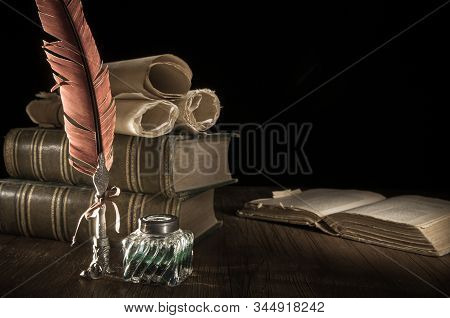 Quill Pen And Old Books