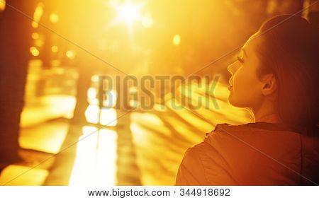 Beautiful young woman enjoying vacation during summer.