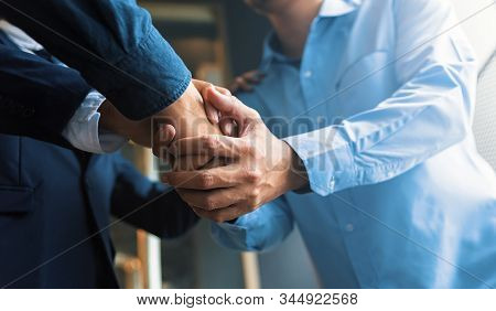 Business Team Work Join Hands Together. Group People Hands Were Collaboration To Trust In Business.
