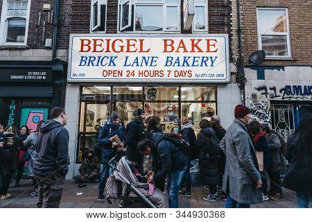 London, Uk - December 29, 2019: Facade Of Brick Lane Bakery In Brick Lane, People Walk In Front, Mot