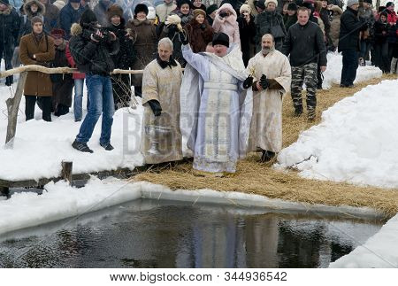 People Look At The Baptismal Rite_