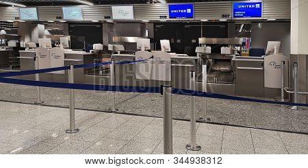 Frankfurt, Germany, 12 26 2019.empty Check-in Counters With Computers, Monitors Luggage Scales, Drop