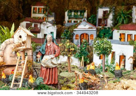Candelaria, Tenerife, Spain - December 12, 2019: Detail of Christmas Belen -  Crib, Nativity Scene, statuette of people and houses in miniature