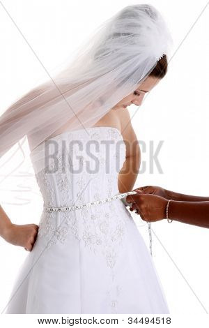 Woman in a wedding dress on white background