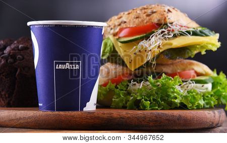 Cup Of Lavazza Coffee And Sandwiches
