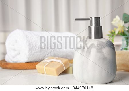 Soap Dispenser And Toiletries On White Table