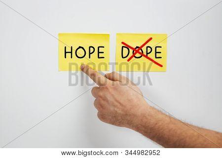 Hope Or Dope, Cropped Man Hand Choose Hope - A Drug Abuse Or Drug Rehabilitation Concept - Say No To
