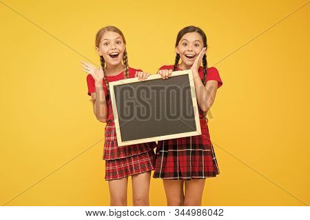 What A Great News. Children Presenting Bulletin Board. Big Sales. Happy Small Girls With Blackboard.