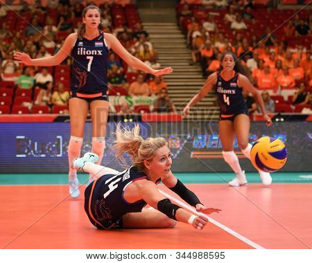 BUDAPEST, HUNGARY – August 23, 2019: Laura Dijkema (14) receives the ball, at the Netherlads (blue) – Romania (yellow) 2019 CEV Volleyball European Championship's women volleyball game.