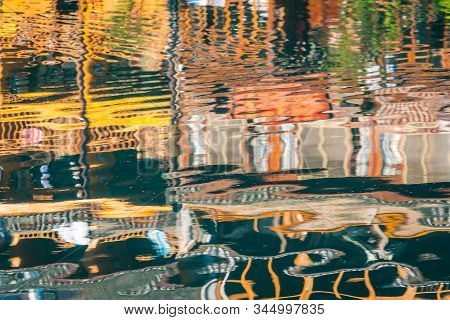 Reflection On The Water Surface Of Traditional Old Wooden Houses On The Riverbanks Of Tuo River, Flo