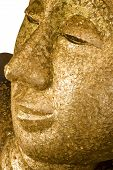 Close up of ancient reclining buddha in Wat Pa Pra Doo Thailand poster