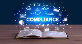 COMPLIANCE inscription coming out from an open book, business concept