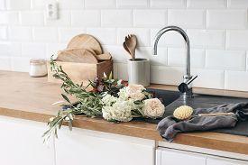 Closeup Of Kitchen Interior. White Brick Wall, Metro Tiles, Wooden Countertops With Kitchen Utensils
