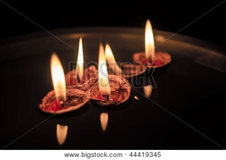 Walnut Shells With Lit Up Candles