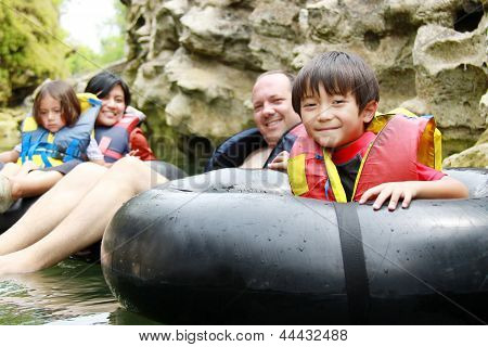 Family On Inflatable Tube