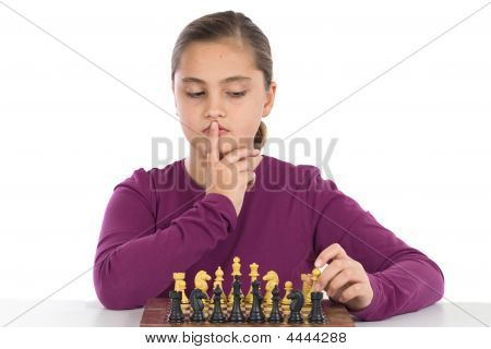 Attractive Little Girl Playing Chess