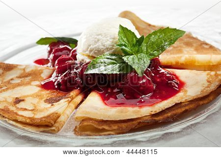 Dessert - Pancakes with Ice Cream and Berries Sauce
