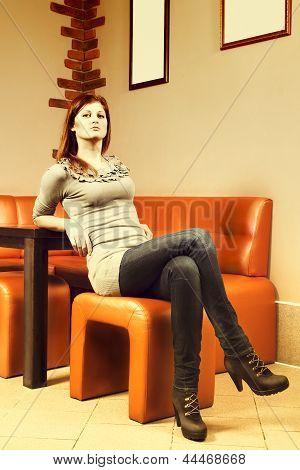 Beautiful girl sitting on chair