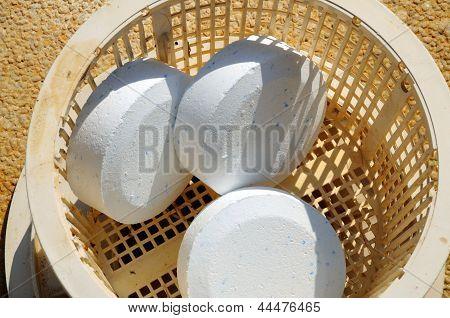 Chlorine tablets in pool skimmer basket.