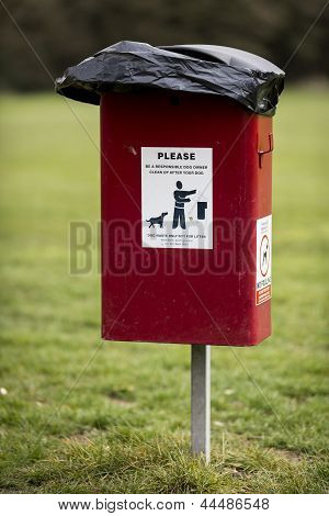 A dog foul waste bin in uk park poster