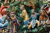 This is Taiwan temple decoration with beautiful color in blue green and yellow.Have Five cute idols. poster
