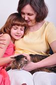 close-up portrait of happy smiling grandmother and granddaughter with their cat poster
