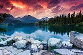 Mountain lake in National Park High Tatra. Dramatic overcrast sky. Strbske pleso, Slovakia, Europe. Beauty world. poster