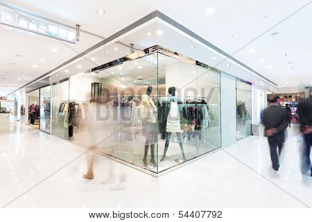 Boutique display window with mannequins in fashionable dresses