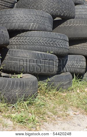 poster of Pile of used old rubber tire stacked on each other