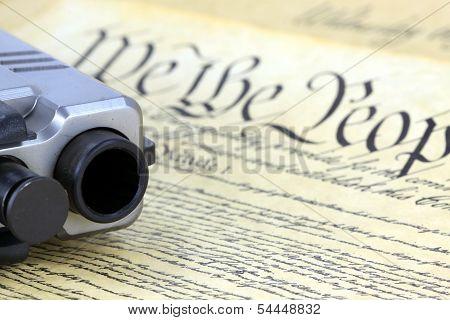 US Constitution with Hand Gun