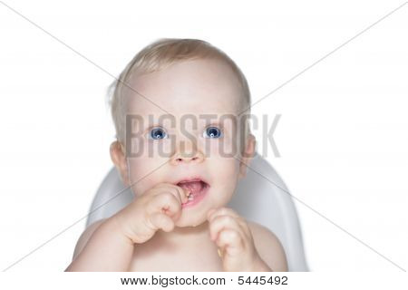 Baby Eating Snacks In High Chair
