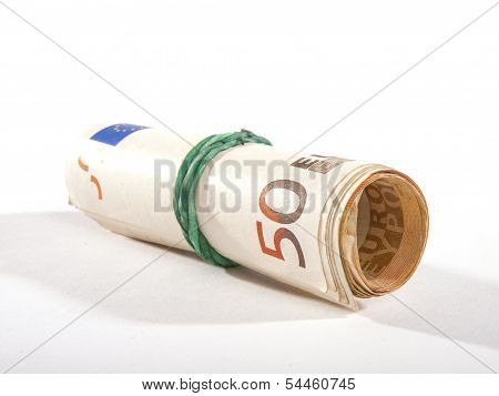 Roll Of Banknotes With Elastic On White Background