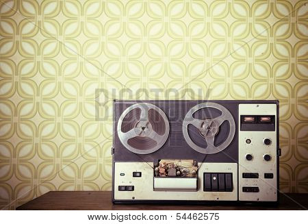 Retro portable reel to reel tube tape-recorder, toned, with copyspace. Toned
