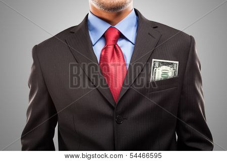 Businessman keeping a 500 Euro Banknote in his pocket