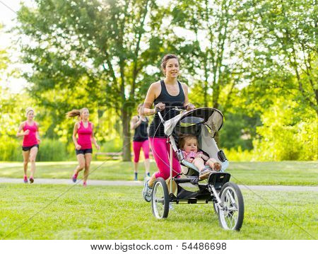 Mother running in the park
