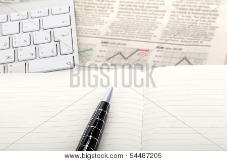 Business Photo: Fresh Newspaper With Stock Index Overview And Open Note With Keyboard