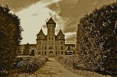Spires of an empty state hospital building cast an eerie atmosphere poster