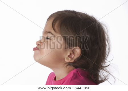 Portrait of a funny baby girl making faces